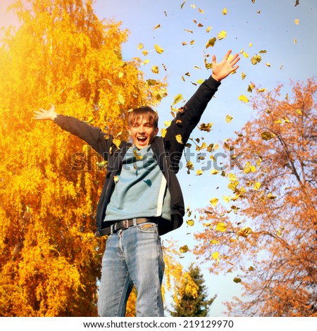 Toned photo of Happy Teenager in the Autumn Park - stock photo