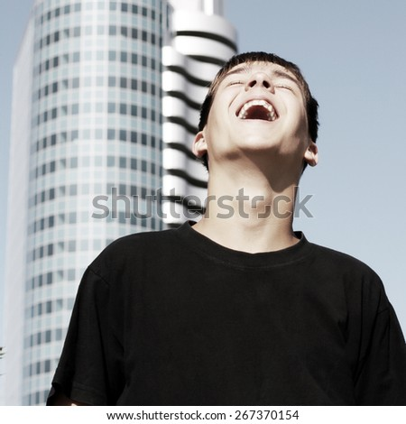 Toned Photo of Happy Teenager in the City - stock photo