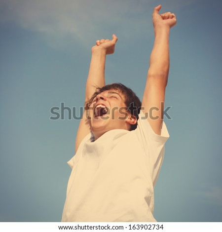 Toned photo of Happy Teenager jumping on sky background - stock photo