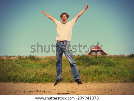 Toned Photo of happy teenager jumping on the beach - stock photo