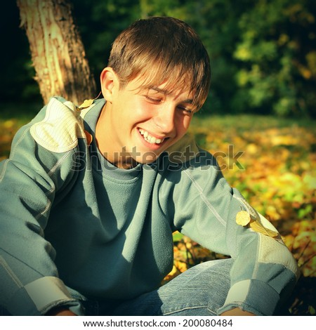 Toned photo of Happy Teenager laughing in the Autumn Park - stock photo