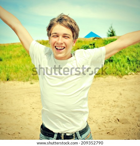 Toned photo of Happy Teenager running at the Summer Day outdoor - stock photo