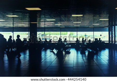 Toned photo of people are waiting for departure in the airport - stock photo