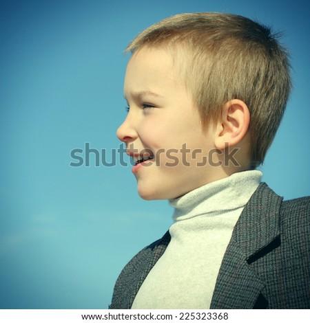 Toned Photo of Portrait of Happy Little Kid outdoor - stock photo
