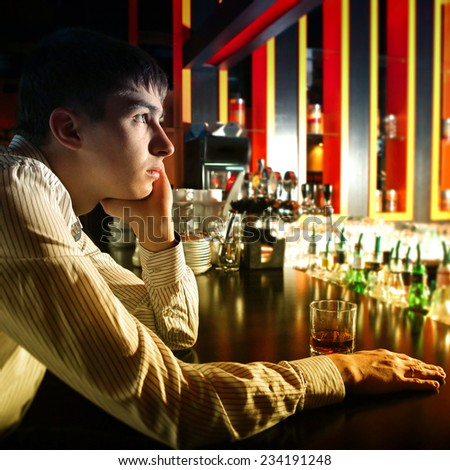 Toned photo of Sad and Lonely Teenager at the Bar counter - stock photo