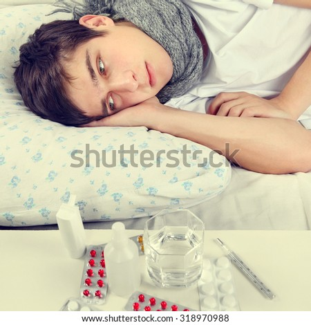 Toned Photo of Sad and Sick Young Man on the Bed - stock photo