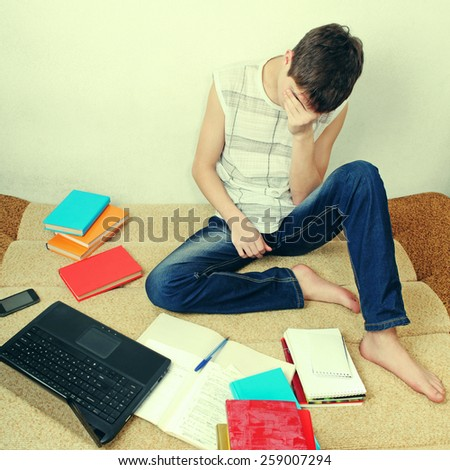 Toned Photo of Sad Teenager on the Sofa with the Books - stock photo