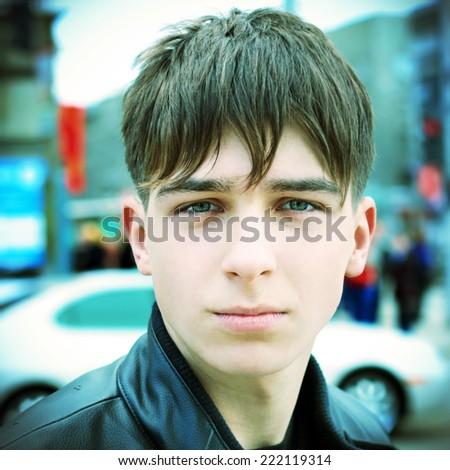 Toned Photo of Sad Teenager Portrait on the City Street - stock photo