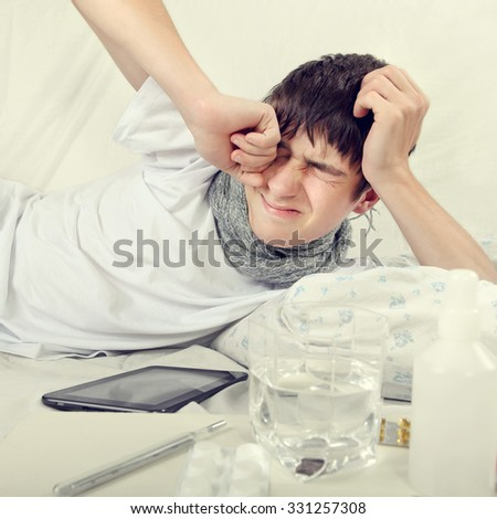 Toned Photo of Sick and Tired Young Man in the Bed - stock photo