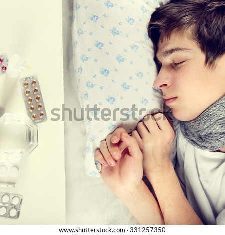 Toned Photo of Sick Young Man sleep on the Bed - stock photo