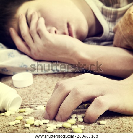 Toned Photo of Teenager sleep with the Pills on the Bed