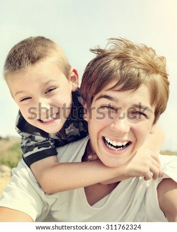 Toned Photo of the Happy Brothers Portrait outdoor - stock photo