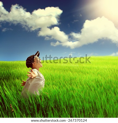 Toned Photo of the Happy Child in the Field - stock photo