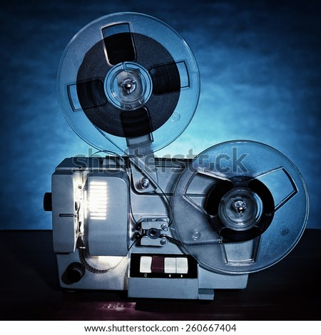 Toned Photo of the Old Film Projector in Dusk on the Table - stock photo