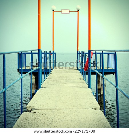 Toned Photo of the Pier in a Summer Day - stock photo