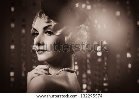 Toned picture of  elegant blond retro woman   wearing little hat - stock photo