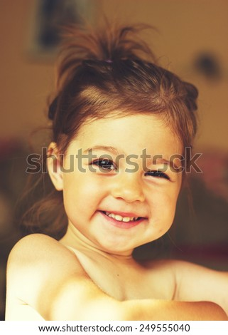 Toned portrait of a beautiful little girl smiling closeup - stock photo