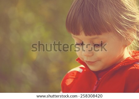 Toned portrait of happy cute smiling girl - stock photo