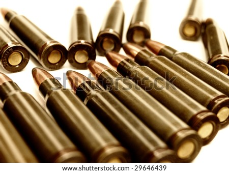 toned set of Kalashnikov AK-47 (7.62 mm) cartridge. Set of cartriges with bright brass bullets  in row on white background