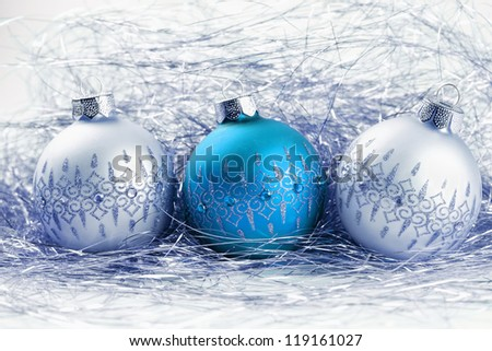 toned shot of background from christmas balls with tinsel