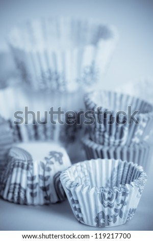 toned shot of baking paper cups for cupcakes or muffins