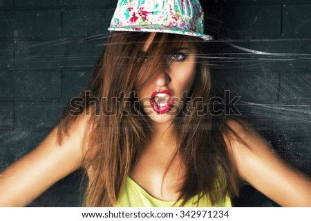 Toned vintage toned portrait sexy swag hipster girl, wearing cap, bright make up, looking an camera. - stock photo