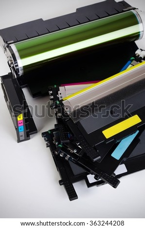 Toner cartridge set for laser printer. Computer supplies on white background. - stock photo
