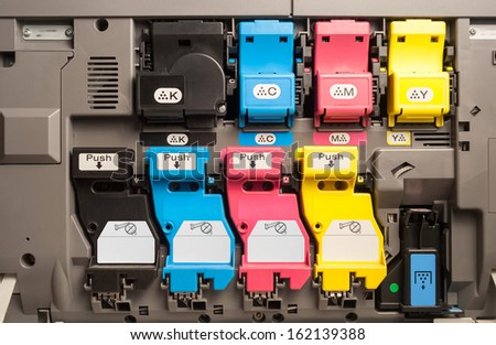 Toner cartridges of a color laser printer - stock photo