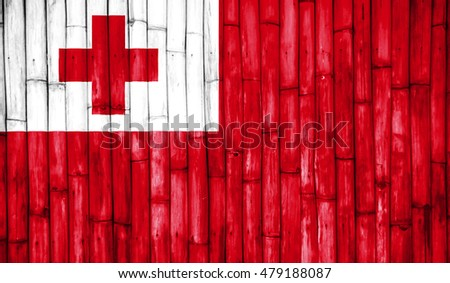 Tonga country flag paint on a bamboo textured.
