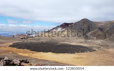 Tongariro Alpine crossing - most spectacular tramping track in New Zealand - stock photo
