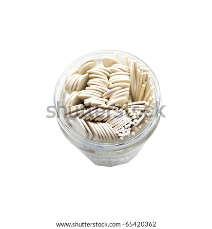 tongue depressors and swab in a glass jar