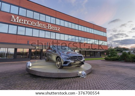 TONGWELL,MILTON KEYNES,ENGLAND - FEBRUARY,2016. Mercedes GLC SUV on display in front of Mercedes-Benz Head Office - stock photo