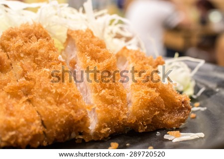 Tonkatsu serve with slice cabbage. Deep Fires pork loin. Most favorites Japanese food.  made by pork lion with bread crumb. deep fry to golden brown colour - stock photo