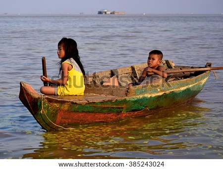 Tonle Sap Lake, Siem Reap / Cambodia � Feb. 2nd 2016: Orphan kids near a floating school in a floating village on Tonle Sap Lake.