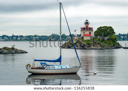 Too cloudy for sailing near Pomham Rock Lighthouse in Providence, Rhode Island. - stock photo