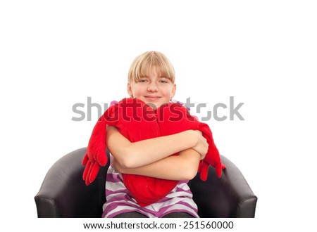 Too much sitting linked to heart disease - Nice girl sitting on a black chair and embracing a red plush heart.