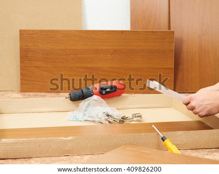Tool and furniture for self-Assembly.Assembling furniture. - stock photo