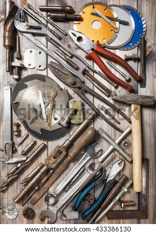 Tool background. Old vintage metal tools collection on wooden workbench. Copy space. Top view, flat lay - stock photo