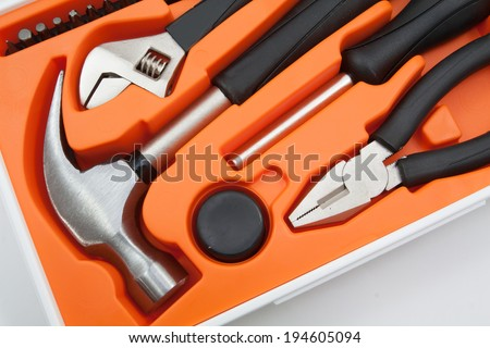 Tool box set containing a hammer, pliers, screwdriver and removable screwdriver heads. - stock photo
