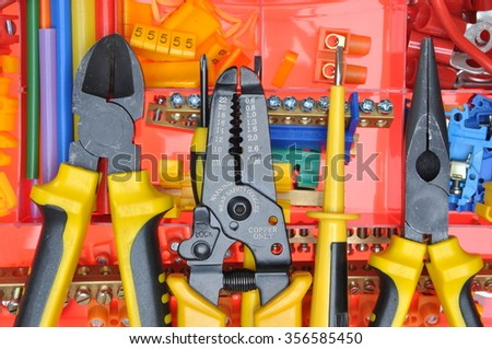 Tool box with electrical tools and components - stock photo