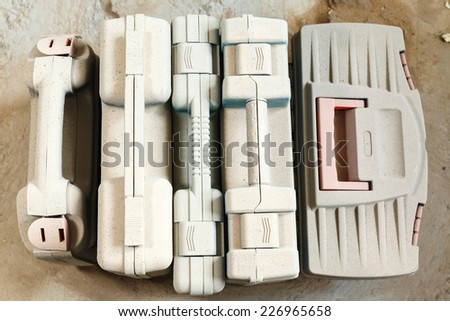 tool boxes under a layer dust closeup - stock photo