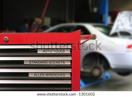 Tool Cabinet with car in the background - stock photo