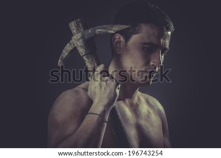 Tool, Construction worker portrait holding a peak. - stock photo