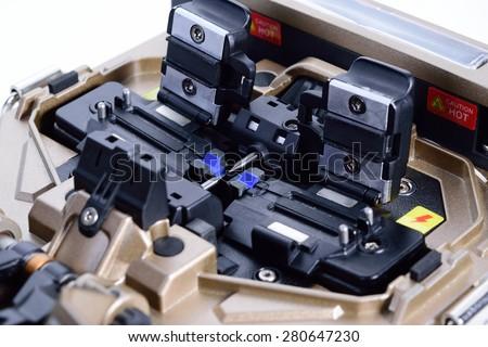 Tool for connecting optical fibers. Welding of optical fibers. - stock photo
