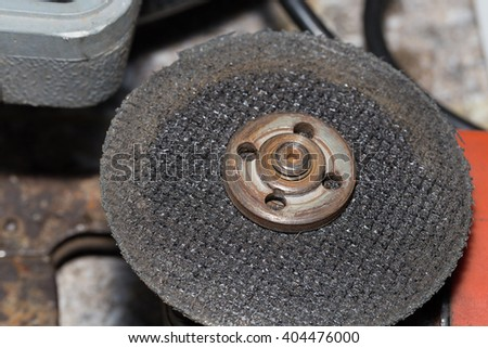Tool grinding tiles. The blade is used to cut the tiles. - stock photo