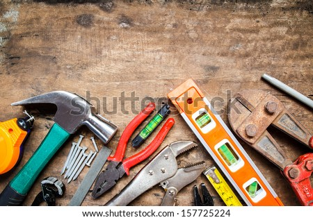 tool renovation on grunge wood - stock photo