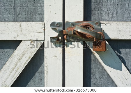 Tool Shed Door with Rusty Lock and Handle - stock photo