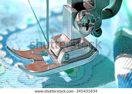 Tool tailor on blue fabric - stock photo