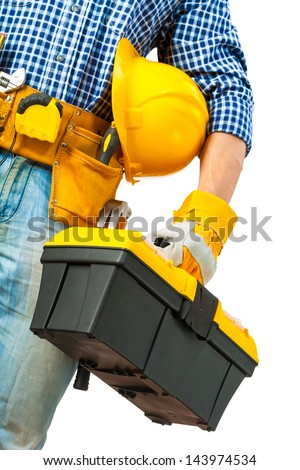 toolbox in hand of worker - stock photo