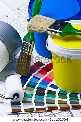 tools and accessories for home renovation on an architectural drawing - stock photo
